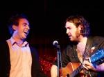 Nick Helm sings to a nervous audience member